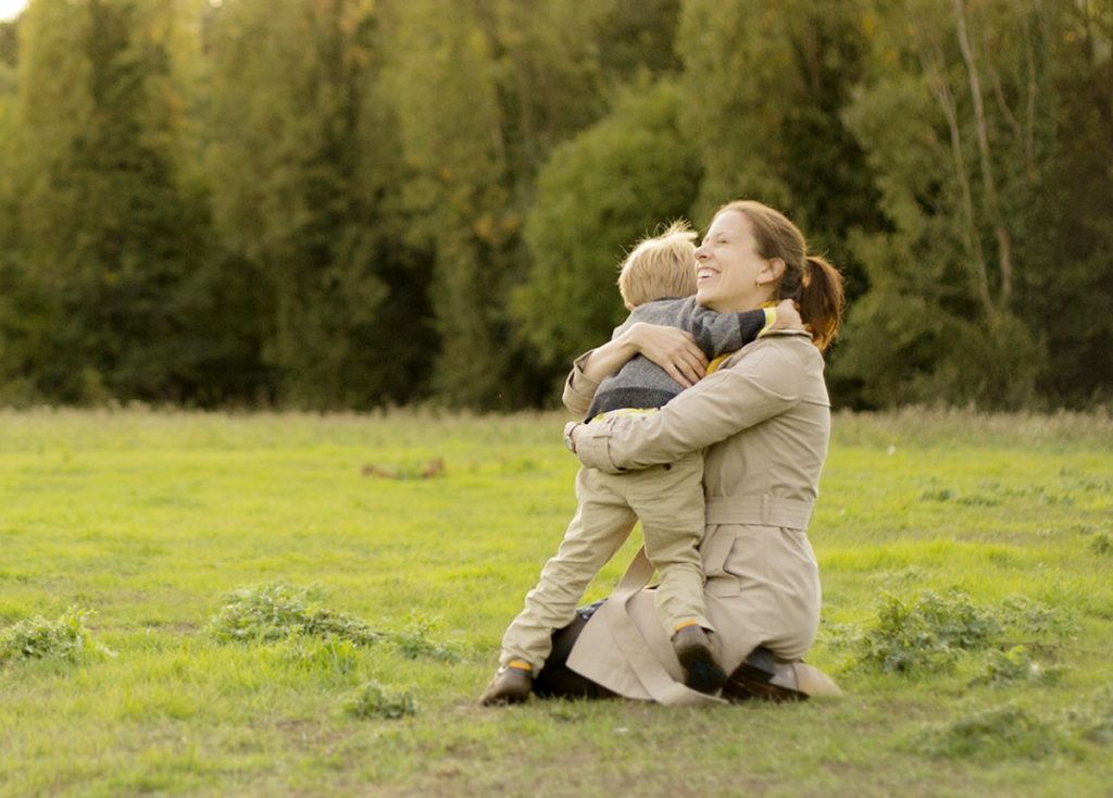 Mother and son hugging during family photography session in West London