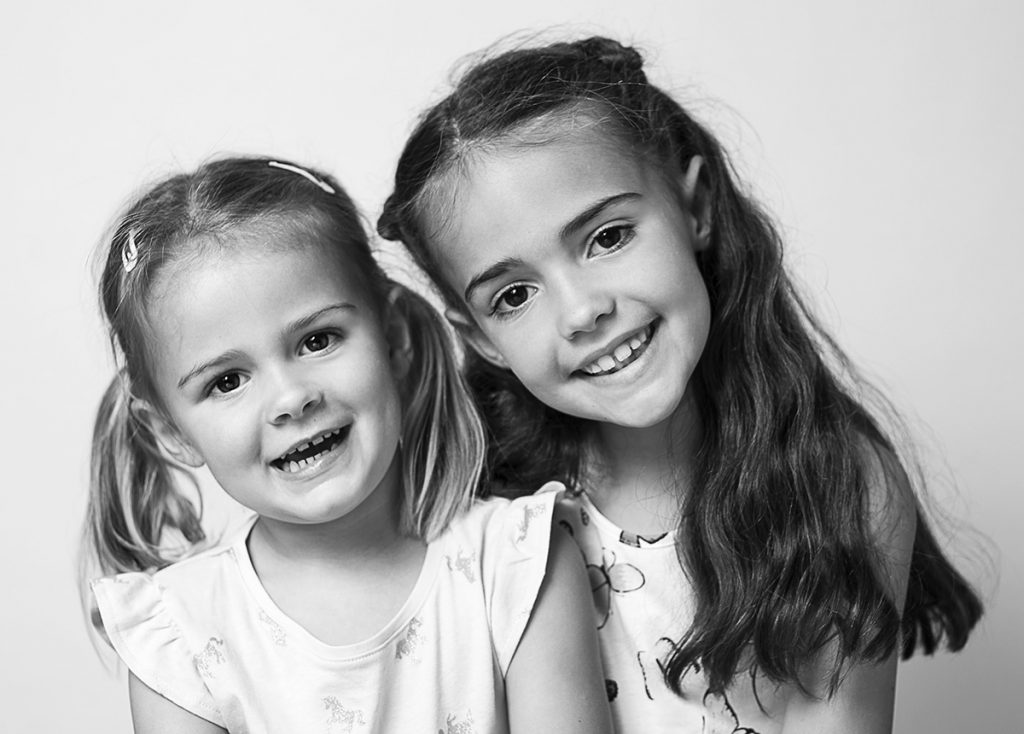 London family portrait photography. Sisters studio portrait by Jayne Douglas