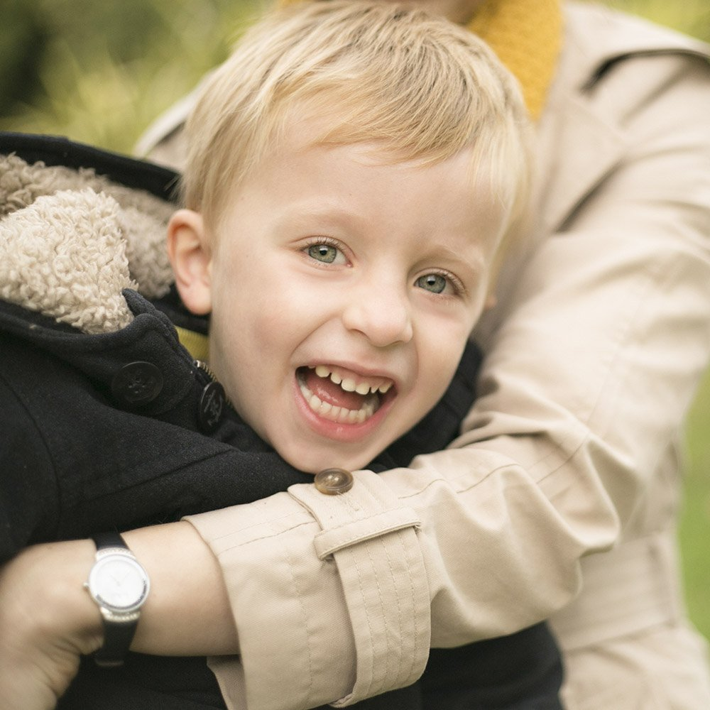 A young boy gets a cuddle during a West London family photo shoot