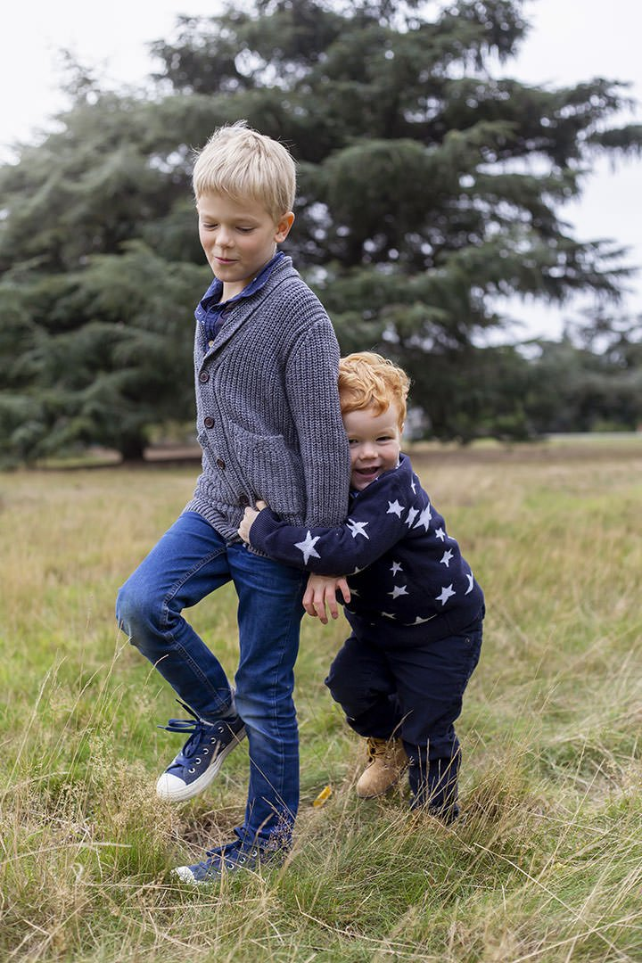 London family photoshoot in Ealing. Brothers playing